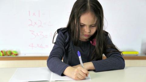 Student At Desk Doing Math Homework stock footage