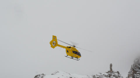 mountain helicopter snowy dolomites three peaks 11752 Footage