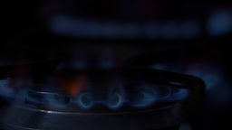 Blue gas flames on stoves lit/turn off Footage