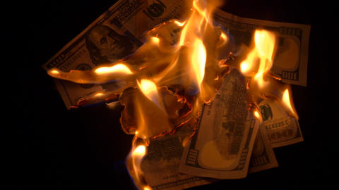 Burning 100 dollars bills Footage