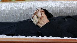 Dead unidentified person in a coffin. Close up shot at hands Footage