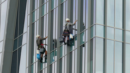 Two window cleaners at work Footage