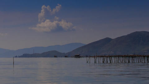 view of defocused mountain islands with fish-net sticks Footage