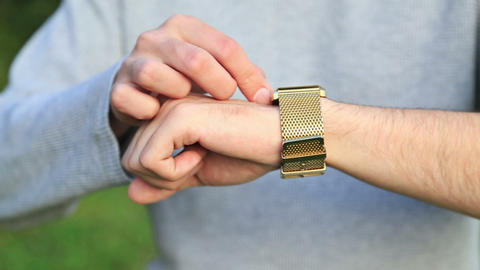 Man checking the time on his wrist watch Footage
