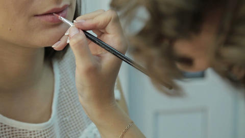 Visagist applying lipstick to woman in beauty salon Footage