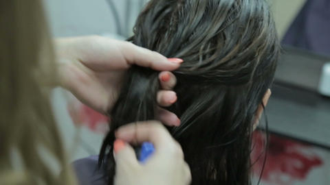 Close-up hairdresser combing and blow dry for client hair in hairdressing salon Live Action