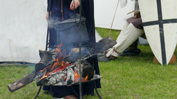 Women in medieval outfit are cooking meal Footage