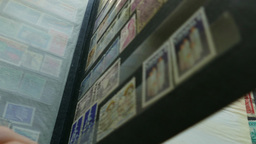 Watching an international stamp collection Footage