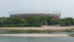The National Stadium building and Vistula river. Warsaw, Poland Live Action