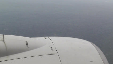 View at Airplane Engine over Sea 01 handheld Stock Video Footage