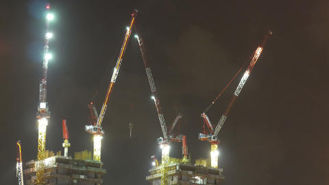 Time lapse of skyscraper construction in the evening Footage