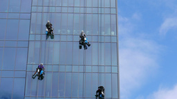 Four window cleaners at work 2 Footage