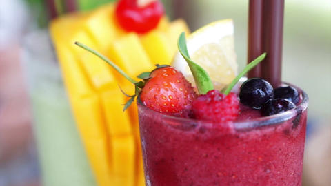 Berries smoothies and mango tropical drink Footage