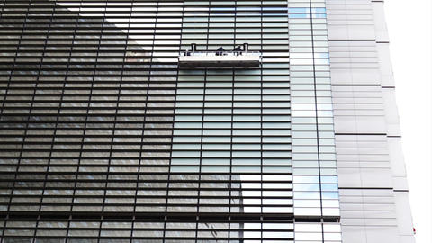 Cleaning The Windows of a Modern Glass Skyscraper Office Building Footage
