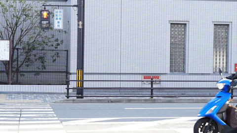 KYOTO, JAPAN - MARCH 2015: Commuter and traffic crossing at ordinary regular str Footage