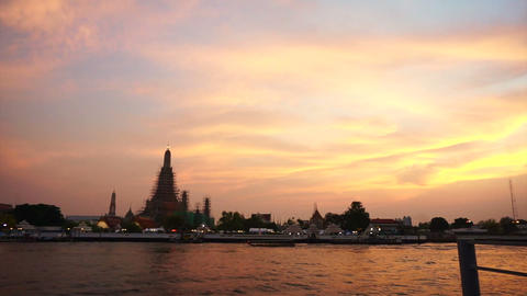 Wat Arun at Sunset, Temple of the Dawn in Bangkok, Thailand, Chao Phraya River.  Footage