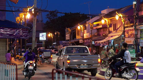 THAILAND -April 2015: Roundabout in suburban Thailand. Local town usual traffic  Live Action