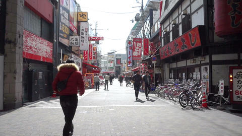 Osaka, Janpan - March 2015: Pedestrians walking around the Dotonbori shopping di Footage