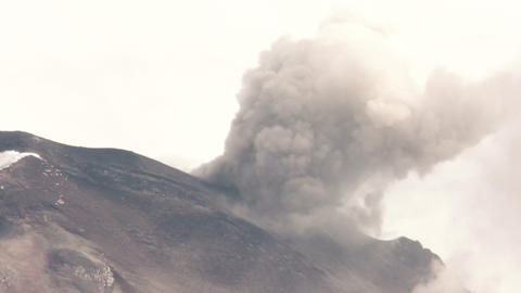 birds of prey flying against erupting volcano Footage