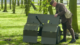 Bofors 37mm gun. An anti-tank gun and soldier in World War II uniform Live Action