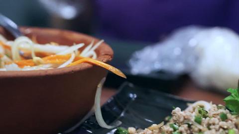 Asian teenage girl enjoy eating tasty Thai food, Papaya salad and other spicy fo Footage