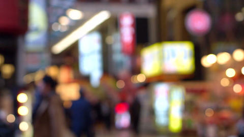 People walking in city night light background. View of busy big city, Osaka, Jap Footage
