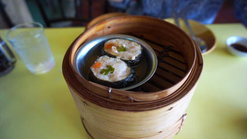 Steaming Dim Sum open in different layers traditional Live Action
