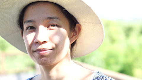 Asian woman enjoy herself in hot tropical nature holiday wearing summer hat Footage