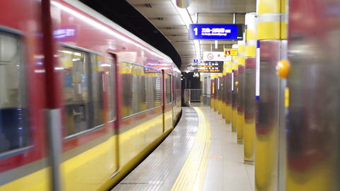 Osaka, Japan - MARCH 2015: Train running through subway station's platform with  Footage