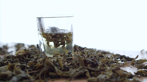 Tea Leaf Dissolving In Hot Water On White Background stock footage