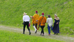 People in medieval costume - walk in slow motion Live Action