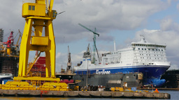 Harbor cranes, shipyard and ships in docks in Gdansk, Poland Footage