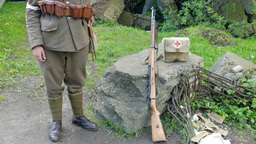 WW2 soldier on guard with paramedic band on his arm Footage