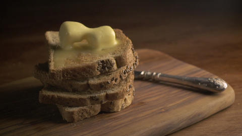 Stack of bread slices and melting butter Footage