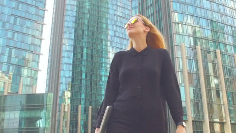 Businesswoman walking along the street Footage