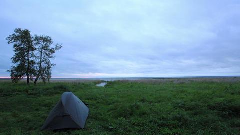 Tourist tents. Sunset on the lake Ik, Krutinsky District, Omsk region, Russia, F Footage
