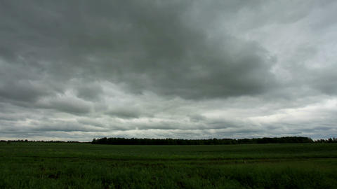 Movement of clouds over a dirt road. Ishimsky district, Tyumen region, Russia, F Footage