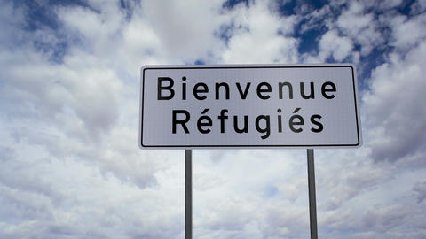 Sign Refugees Welcome French Timelapse stock footage