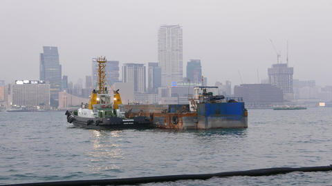 Towboat and barge at Victoria harbour in dusk, parallax shot Footage