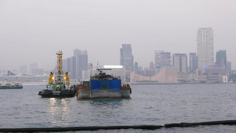 Tugboat And Barge On Calm Waters Of Victoria Harbor In Dusk stock footage