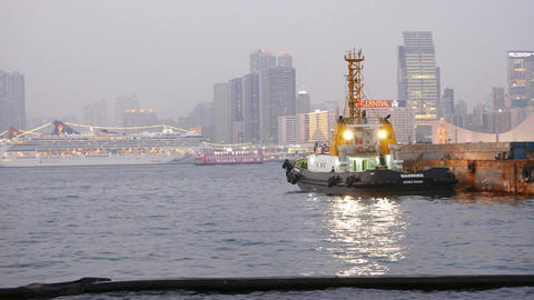 Tugboat standing beside barge vessel at harbour waters, parallax shot Footage