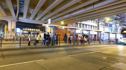People waiting for the tram on public transport stop Footage