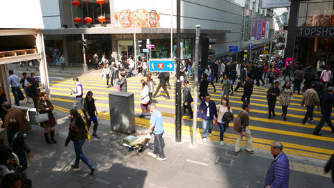 Bright sun lit pedestrian crossing, asian people walk across T-junction Footage