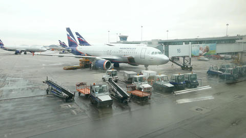 Aeroflot airplane flight preparation, luggage container lift up by truck Footage