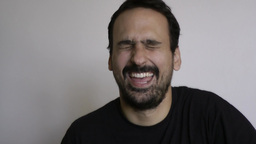 Man Is Laughing With What He Is Hearing stock footage