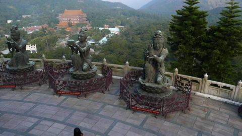 Three small statue on basement of Big Buddha monument Live Action