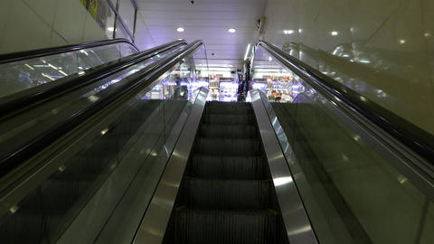 Tight escalator, travelling up, Point of view Footage