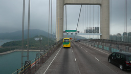 Drive along large Tsing Ma suspension bridge, cloudy mountains of Ma Wan ahead Footage
