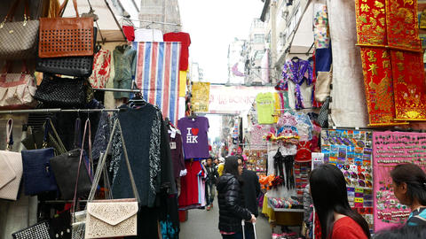 Colorful street market, sides hand with goods and souvenirs Footage