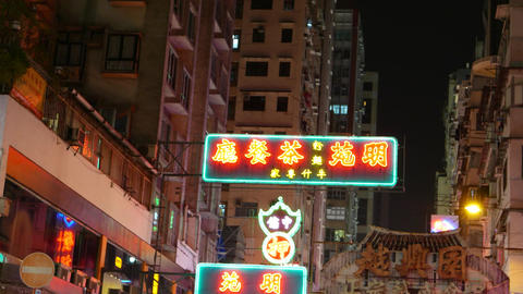 Orange-red Colored Chinese Neon Sign With Green Frame, Bright Glow In Night City stock footage